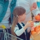 Little Girl Is Buying Oranges Girl Herself Chooses Food in the Hypermarket - VideoHive Item for Sale