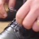 Man Ties Up His Shoelaces on His Black Shoes - VideoHive Item for Sale