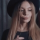 Beautiful Blonde in a Black Hat Makes a Selfie in a Store - VideoHive Item for Sale