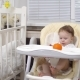 Baby with Tangerine Is Sitting at Table - VideoHive Item for Sale