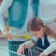 Little Girl Is Buying Oranges. Girl Herself Chooses Food in the Hypermarket - VideoHive Item for Sale