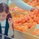 Little Beautiful Girl Choosing Fruits While Her Parents - VideoHive Item for Sale