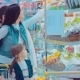Mother, Father and Children Picking Out Fruit in Supermarket - VideoHive Item for Sale