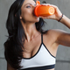 close up portrait of drinking sportswoman in gym - PhotoDune Item for Sale