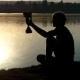 Lucky Man Plays with His Champion Bowl at a Lake - VideoHive Item for Sale