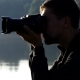 Young Man Shoots a Nice Lake with His Camera at Sunset - VideoHive Item for Sale
