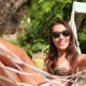 Mixed Race Young Tourist Woman Taking Smartphone Selfie Picture Relaxing in Hammock on Tropical - VideoHive Item for Sale