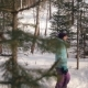 A Young Woman Walks Through the Winter Forest and Photographs Nature - VideoHive Item for Sale
