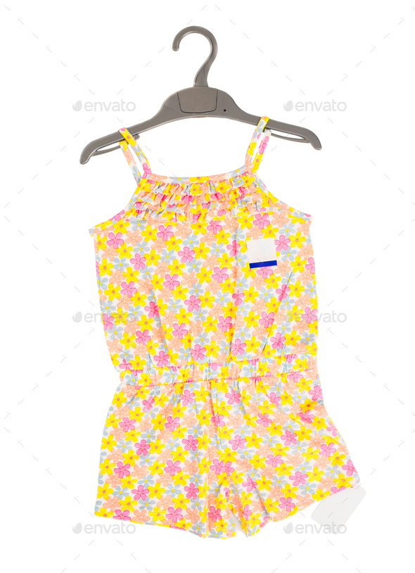 Child cotton overalls with floral pattern. - Stock Photo - Images