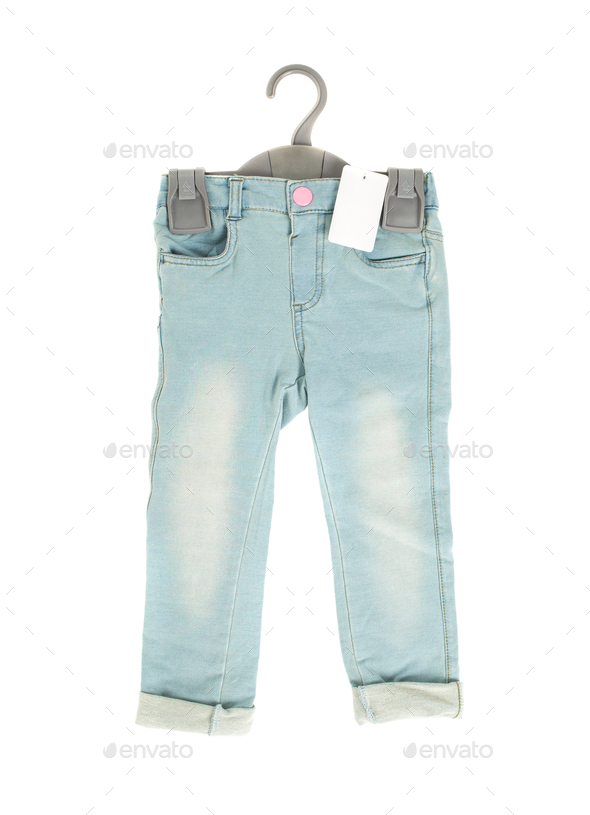 Children blue jeans with blank label. - Stock Photo - Images