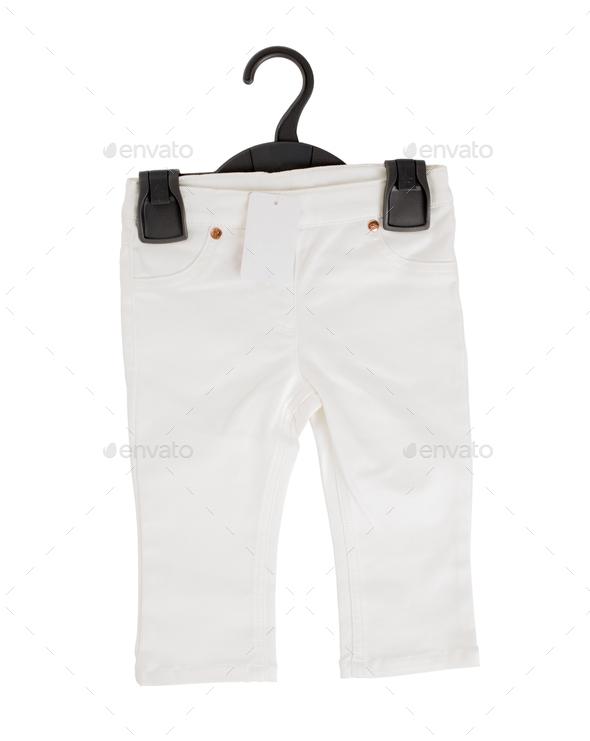 White denim shorts on black plastic hanger. - Stock Photo - Images
