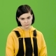 Teenage Girl Looks Forward Angrily. Green Screen - VideoHive Item for Sale