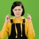 Teenager Crossed Her Fingers in the Hope of Good Grades. Green Screen - VideoHive Item for Sale