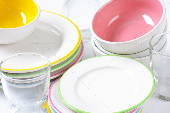 set of rimmed plates, bowls and glasses - Stock Photo - Images