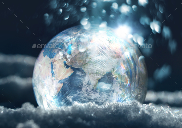 Frozen planet Earth climate change concept - Stock Photo - Images