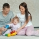 Happy Family Playing at Home. Family Sitting on Floor and Playing Together - VideoHive Item for Sale