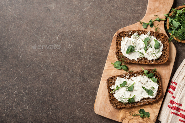 Rye bread with cheese cream and pea sprouts - Stock Photo - Images