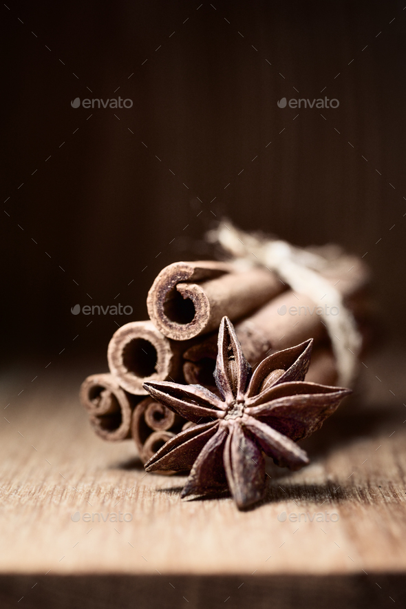 cinnamon and anise on wooden table - Stock Photo - Images