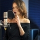 Beautiful Woman Singing Into a Large Microphone. Professional Recording Studio. - VideoHive Item for Sale