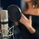 Professional Microphone in the Recording Studio Background of a Singing Woman - VideoHive Item for Sale