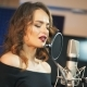 Beautiful Woman Singing Into a Large Microphone. Professional Recording Studio - VideoHive Item for Sale