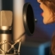 Young Woman Recording a Song in a Professional Studio - VideoHive Item for Sale