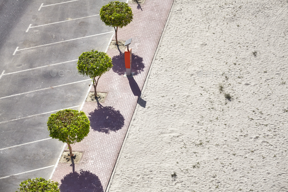 Aerial picture of an empty parking lot by a beach - Stock Photo - Images
