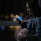 Pregnant Woman at Night Talking on a Mobile Phone Touching His Stomach - VideoHive Item for Sale