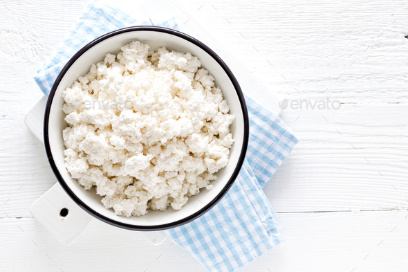 Cottage cheese, curd on white wooden rustic table, top view - Stock Photo - Images