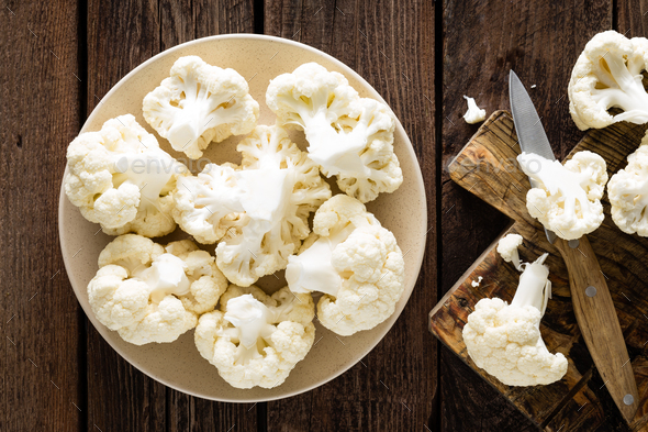 Fresh cauliflower on wooden board. Raw cauliflower. Top view - Stock Photo - Images