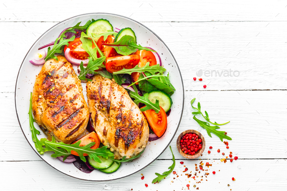 Grilled chicken breast and fresh vegetable salad - Stock Photo - Images