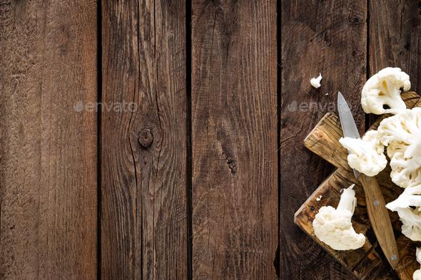 Fresh cauliflower on wooden board. Raw cauliflower. Top view - Stock Photo - Images