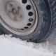 Car Wheel on a Winter Road