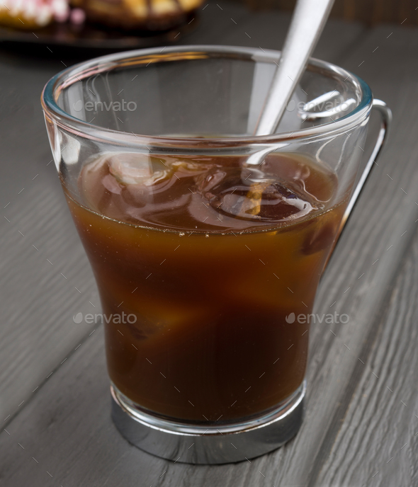 cup of coffee with ice on black base - Stock Photo - Images