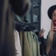 Beautiful Girl Chooses Clothes in the Store. Shoots Himself on a Smartphone - VideoHive Item for Sale