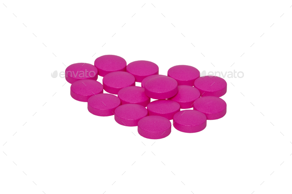 Pink pills on a white background - Stock Photo - Images
