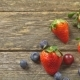 Summer Fruits on a Wooden Table Blueberries Grape Strawberries   Video - VideoHive Item for Sale