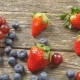 Tasty Summer Fruits on a Wooden Table Blueberries Grape Strawberries Blackberries   Video - VideoHive Item for Sale