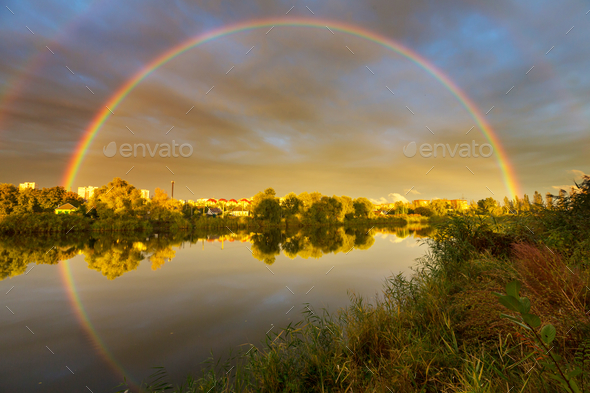 Rainbow on the lake - Stock Photo - Images