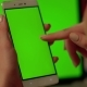 Lady Touches Phone with Green Screen - VideoHive Item for Sale
