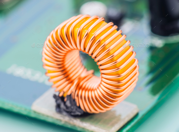 microcoil mounted on electronic circuit board - Stock Photo - Images