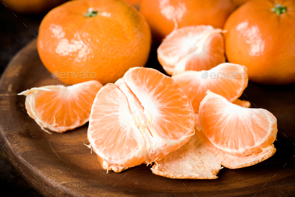 segments of tangerines on classic rustic wood - Stock Photo - Images