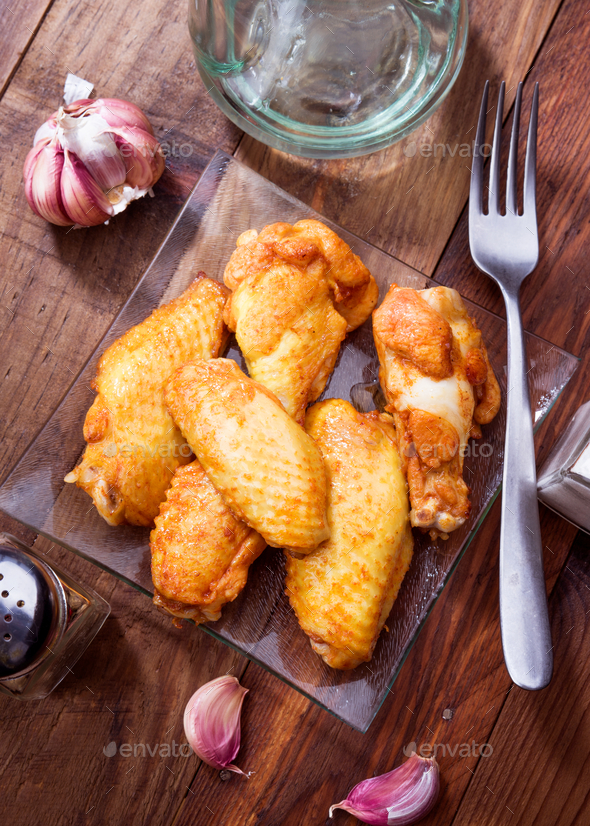 chicken wings cooked on rustic wooden board - Stock Photo - Images