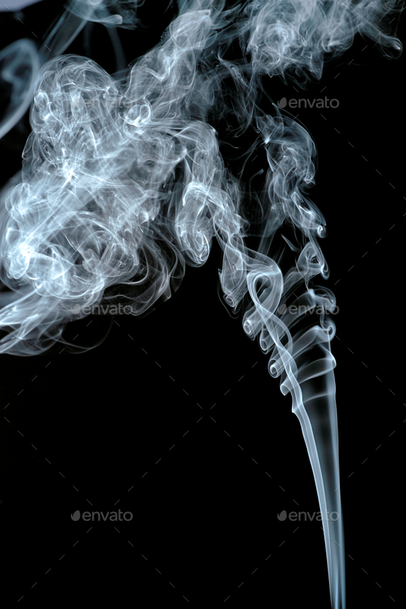 abstract shapes formed by scrolls of incense smoke - Stock Photo - Images