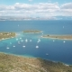 Aerial View of Cozy Mediterranean Island. Blue Lagoon, Island Paradise. Adriatic Sea of Croatia - VideoHive Item for Sale