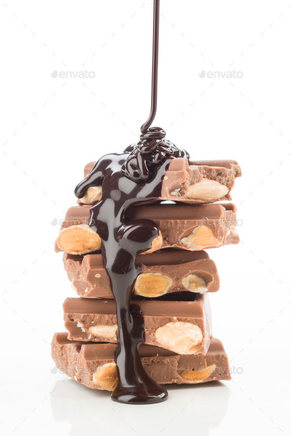 thread of liquid chocolate, falling tower of pieces of chocolate on white background - Stock Photo - Images