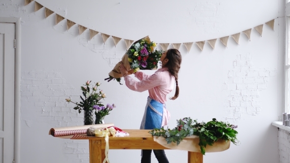 Florist wrapping big and modern bouquet of flowers in paper at play preview video mightylinksfo