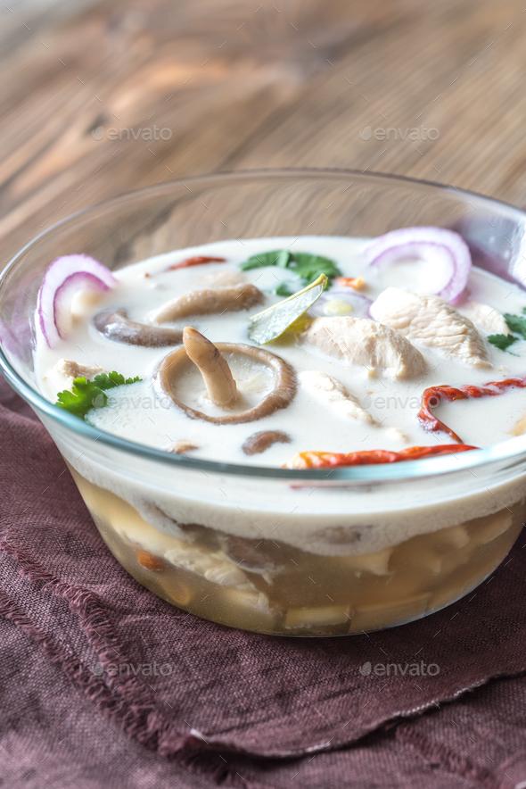 Glass bowl of thai tom kha kai  - Stock Photo - Images