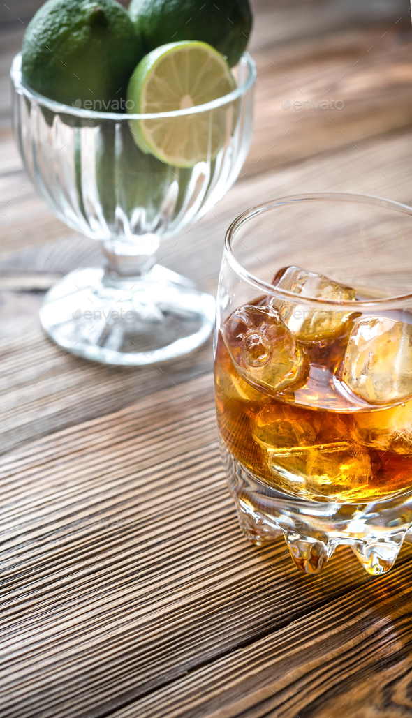 Glass of rum on the wooden background - Stock Photo - Images