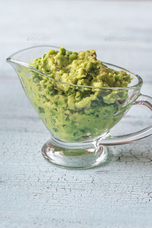 Guacamole in glass gravy-boat - Stock Photo - Images